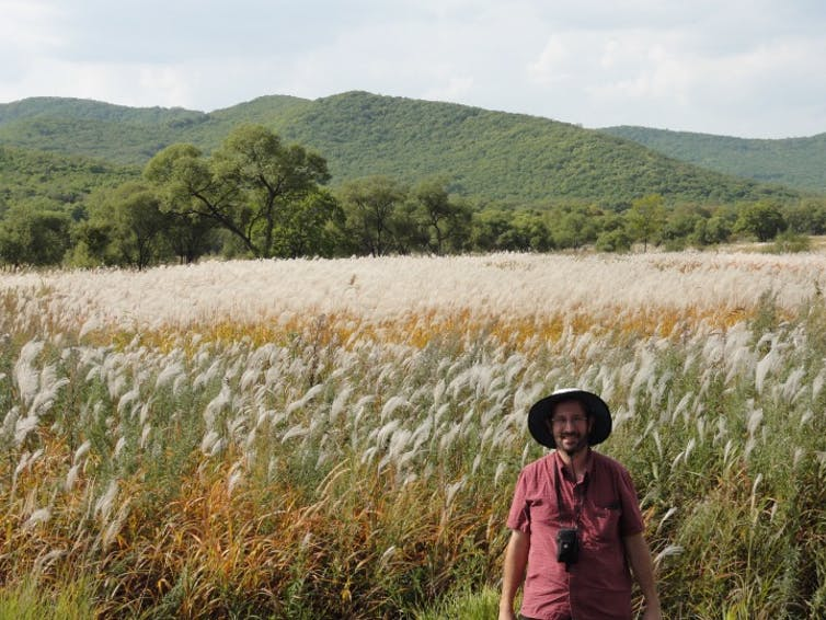 Eric Sacks with Miscanthus